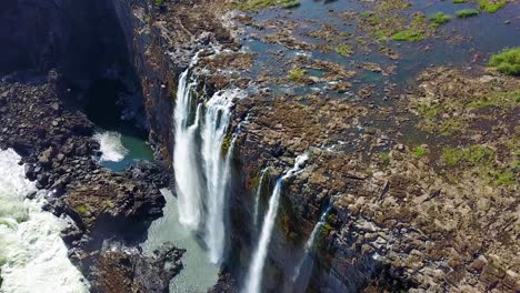 Beautiful-aerial-shot-of-majestic-Victoria-Falls-on-the-Zambezi-River-on-the-border-of-Zimbabwe-and-Zambia-inspiration-of-Africa