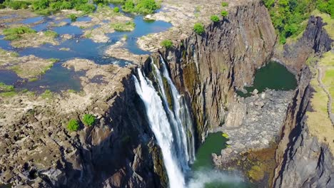 Beautiful-aerial-shot-of-majestic-Victoria-Falls-on-the-Zambezi-River-on-the-border-of-Zimbabwe-and-Zambia-inspiration-of-Africa-1