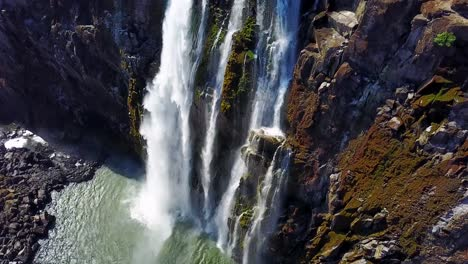 Aerial-shot-of-majestic-Victoria-Falls-on-the-Zambezi-River-on-the-border-of-Zimbabwe-and-Zambia-inspiration-of-Africa