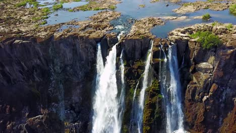 Aerial-shot-of-majestic-Victoria-Falls-on-the-Zambezi-River-on-the-border-of-Zimbabwe-and-Zambia-inspiration-of-Africa-1