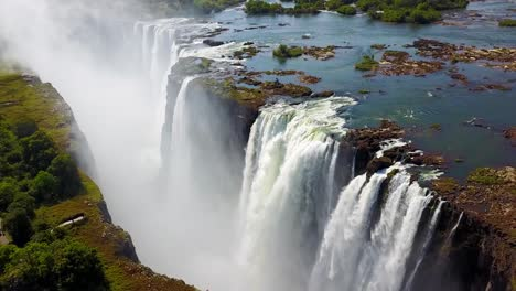 Aerial-shot-of-majestic-Victoria-Falls-on-the-Zambezi-River-on-the-border-of-Zimbabwe-and-Zambia-inspiration-of-Africa-4