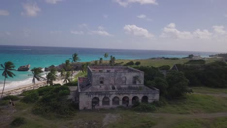 Aerial-over-an-old-abandoned-builidng-along-the-Caribbean-coast-of-Barbados