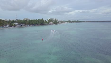 Aerial-over-tourists-riding-a-banana-boat-in-the-Boca-Chica-beach-district-in-the-Dominican-Republic