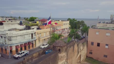Aerial-around-the-flag-of-the-Dominican-Republic-in-Santo-Domingo
