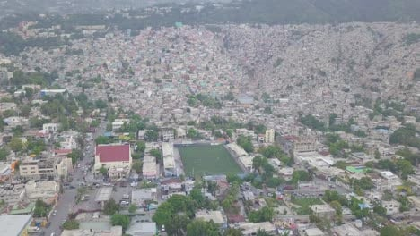 Amazing-vista-aérea-over-the-slums-favela-and-shanty-towns-in-the-Cite-Soleil-district-of-Port-Au-Prince-Haiti-with-soccer-stadium-foreground