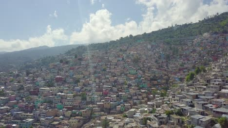 Amazing-aerial-over-the-slums-favela-and-shanty-towns-in-the-Cite-Soleil-district-of-Port-Au-Prince-Haiti-with-soccer-stadium-foreground-1