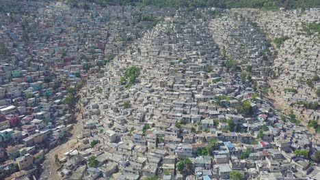 Amazing-aerial-reveals-the-endless-slums-favelas-and-shanty-towns-in-the-Cite-Soleil-district-of-Port-Au-Prince-Haiti-with-soccer-stadium-foreground