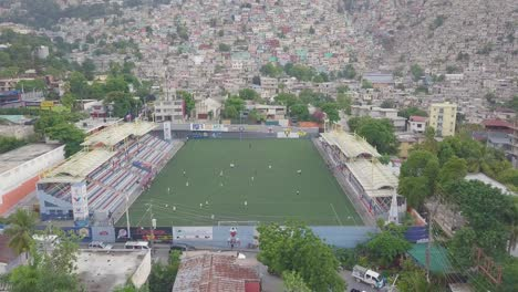 Aerial-over-the-slums-favela-and-shanty-towns-in-the-Cite-Soleil-district-of-Port-Au-Prince-Haiti-with-soccer-stadium-foreground-1