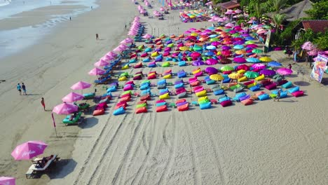 Aerial-over-colorful-beach-umbrellas-in-Sanur-or-Kuta-beach-on-the-coast-of-Bali-Indonesia-1