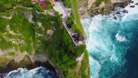 Aerial-over-the-beautiful-Hindu-temple-Tanah-Lot-perched-on-a-cliff-in-Bali-Indonesia-1