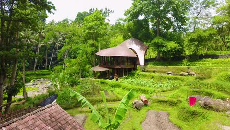 Aerial-move-in-on-a-fantastic-rounded-architectural-house-in-the-jungles-of-Bali-Indonesia