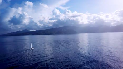 Beautiful-aerial-of-a-sailboat-sailing-across-the-Caribbean-ocean-sea-near-the-island-of-St-Lucia-1