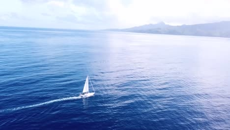 Beautiful-aerial-of-a-sailboat-sailing-across-the-Caribbean-ocean-sea-near-the-island-of-St-Lucia-2