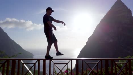 A-man-dances-on-the-balcony-of-a-hotel-at-a-resort-on-the-Caribbean-island-of-St-Lucia-1