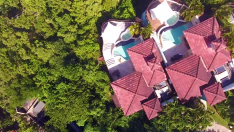 Aerial-of-a-sexy-woman-sitting-beside-a-pool-of-a-condo-or-luxury-home-on-the-Caribbean-Island-of-St-Lucia