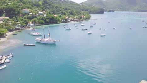 Toma-Aérea-De-Establecimiento-De-La-Isla-Caribeña-De-San-Vicente-Con-Un-Hermoso-Arco-Iris-En-La-Distancia-2