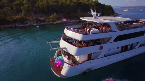 Swimmers-and-partiers-jump-off-a-large-yacht-or-boat-in-the-Adriatic-Sea-near-Croatia