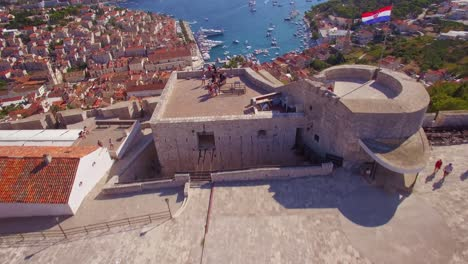 Beautiful-aerial-establishing-shot-over-Hvar-Croatia-and-it-s-distinctive-minarets