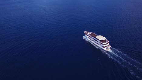 Aerial-over-a-large-yacht-traveling-along-the-coastline-of-Croatia