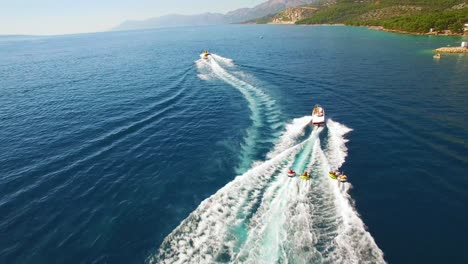 Aerial-of-adventure-boat-towing-four-innertubes-for-a-tubing-adventure-off-the-coast-of-Croatia-2