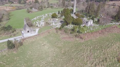 Aerial-over-the-Glendalough-Cemetery-in-Ireland-with-graves-and-visitors