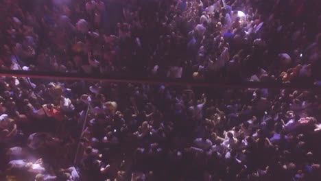 Hypnotic-high-ange-shot-of-huge-crowds-at-a-night-dance-party-club-or-nightclub