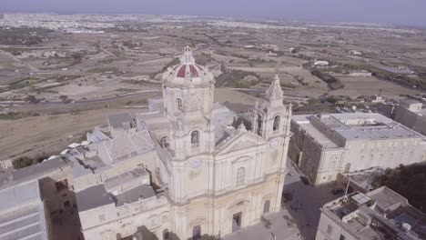 Aerial-around-beautiful-stone-church-on-the-island-of-Malta-