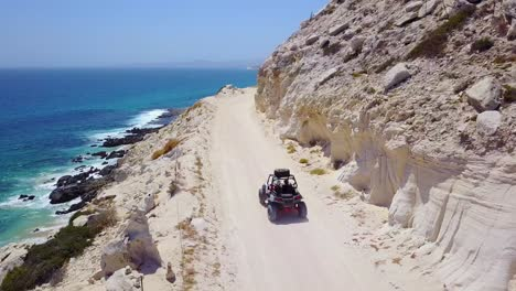 Good-aerial-of-an-ATV-speeding-on-a-dirt-road-near-Cabo-Baja-Mexico-1