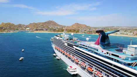 Huge-cruise-ship-aerial-shot-off-coast-Cabo-San-Lucas-Baja-California-Mexico-hotels-and-resorts-along-coast