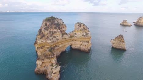 Aerial-of-Lagos-beach-rock-formations-ocean-and-coastline-in-Portugal
