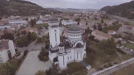 Aerial-over-a-church-in-Sighisoara-Castrum-Sex-in-Romania-birthplace-of-Dracula