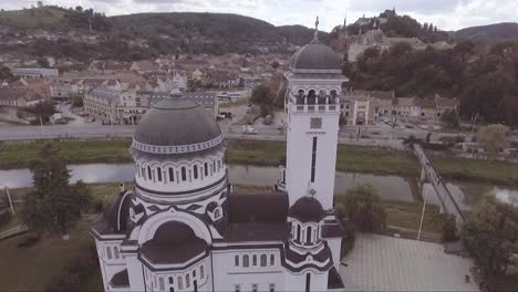 Aerial-over-a-church-in-Sighisoara-Castrum-Sex-in-Romania-birthplace-of-Dracula-1