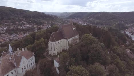 Aerial-over-a-church-or-castle-estate-in-Sighisoara-Castrum-Sex-in-Romania-birthplace-of-Dracula