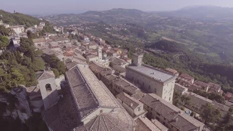 Aerial-over-prepublic-of-San-Marino-hillsides-and-villages-of-Monte-Titano