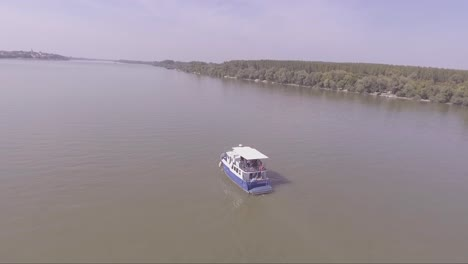 Aerial-of-a-boat-traveling-on-the-Danube-or-Sava-River-near-Belgrade-Serbia