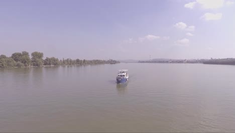 Aerial-of-a-boat-traveling-on-the-Danube-or-Sava-River-near-Belgrade-Serbia-1