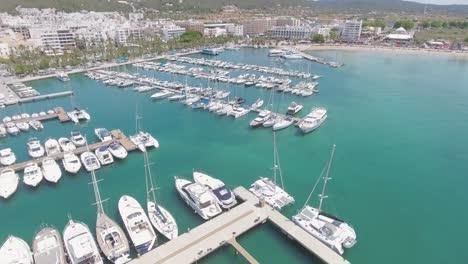 Aerial-establishing-shot-of-Ibiza-Spain-harbor-and-town