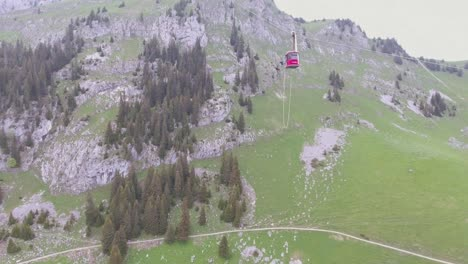 Remarkable-and-crazy-shot-of-a-bungee-jumper-diving-from-a-cable-car-in-Switzerland