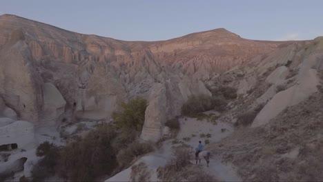 Aerial-of-tourists-riding-horses-horseback-riding-at-Cappadocia-Turkey-3