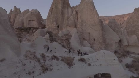 Aerial-of-tourists-riding-horses-horseback-riding-at-Cappadocia-Turkey-4