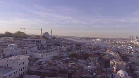 Aerial-of-Instanbul-Turkey-old-city-skyline-with-mosques-and-Bosphorus-River-bridges-distant