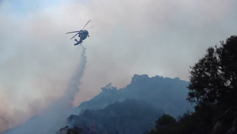 A-Helicopter-Makes-Water-Drops-During-The-Woolsey-Fire-Near-Malibu-California-1