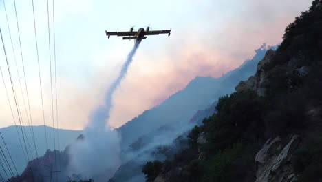 A-Fixed-Wing-Aircraft-Makes-Water-Drops-During-The-Woolsey-Fire-Near-Malibu-California