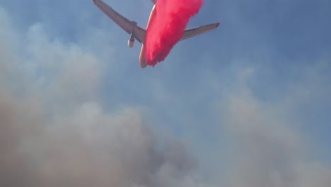 An-Aerial-Tanker-Plane-Aircraft-Makes-A-Pink-Phoschek-Fire-Retardant-Drop-Over-A-Wildfire-Burning-In-The-Hills-Above-Southern-California