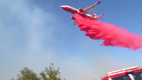 An-Aerial-Tanker-Plane-Aircraft-Makes-A-Pink-Phoschek-Fire-Retardant-Drop-Over-A-Wildfire-Burning-In-The-Hills-Above-Southern-California-1