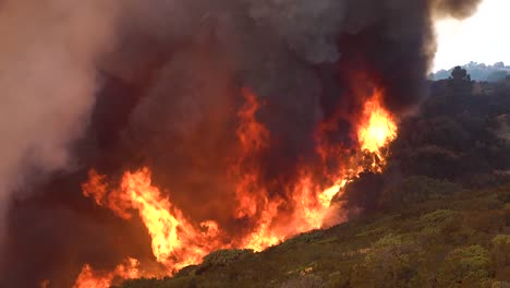 A-Massive-Fast-Moving-Wildifre-Burns-As-A-Huge-Brush-Fire-On-The-Hillsides-Of-Southern-California-During-The-Cave-Fire-In-Santa-Barbara