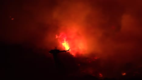 A-Helicopter-Makes-A-Dramatic-Water-Drop-At-Night-Responding-To-The-Cave-Fire-Near-Santa-Barbara-California
