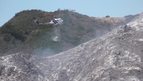 Helicopter-Water-Drop-And-Firefighters-Mop-Up-After-A-Brush-Fire-Burns-A-Hillside-Near-Hollister-Ranch-In-Santa-Barbara-California-1