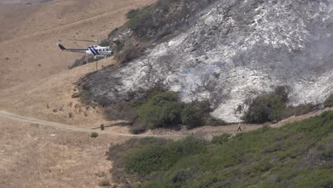 Helicopter-Water-Drop-And-Firefighters-Mop-Up-After-A-Brush-Fire-Burns-A-Hillside-Near-Hollister-Ranch-In-Santa-Barbara-California-2