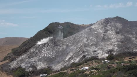 Helicopter-Water-Drop-And-Firefighters-Mop-Up-After-A-Brush-Fire-Burns-A-Hillside-Near-Hollister-Ranch-In-Santa-Barbara-California-3